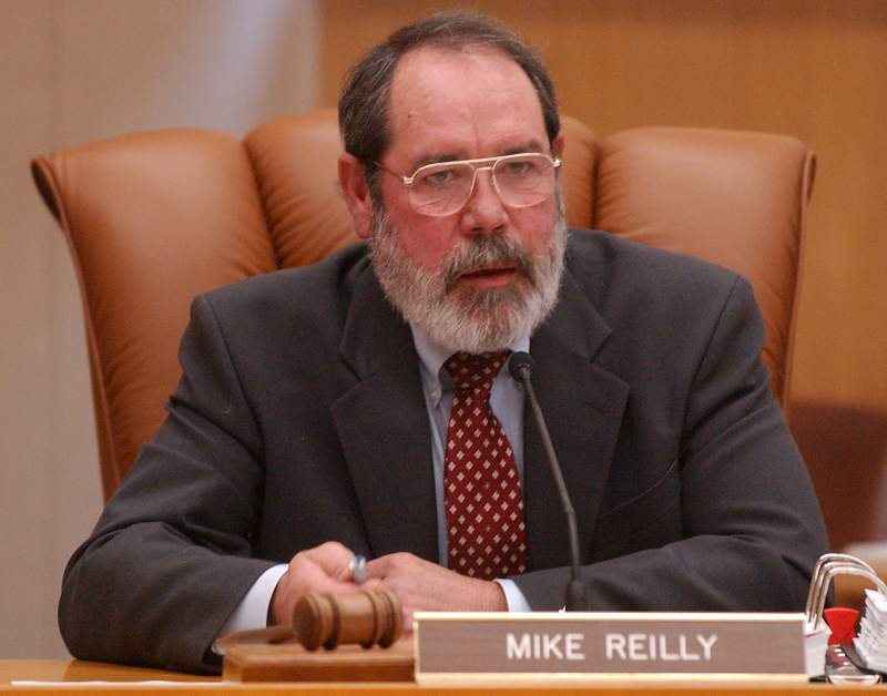 Mike Reilly Sitting At His Desk