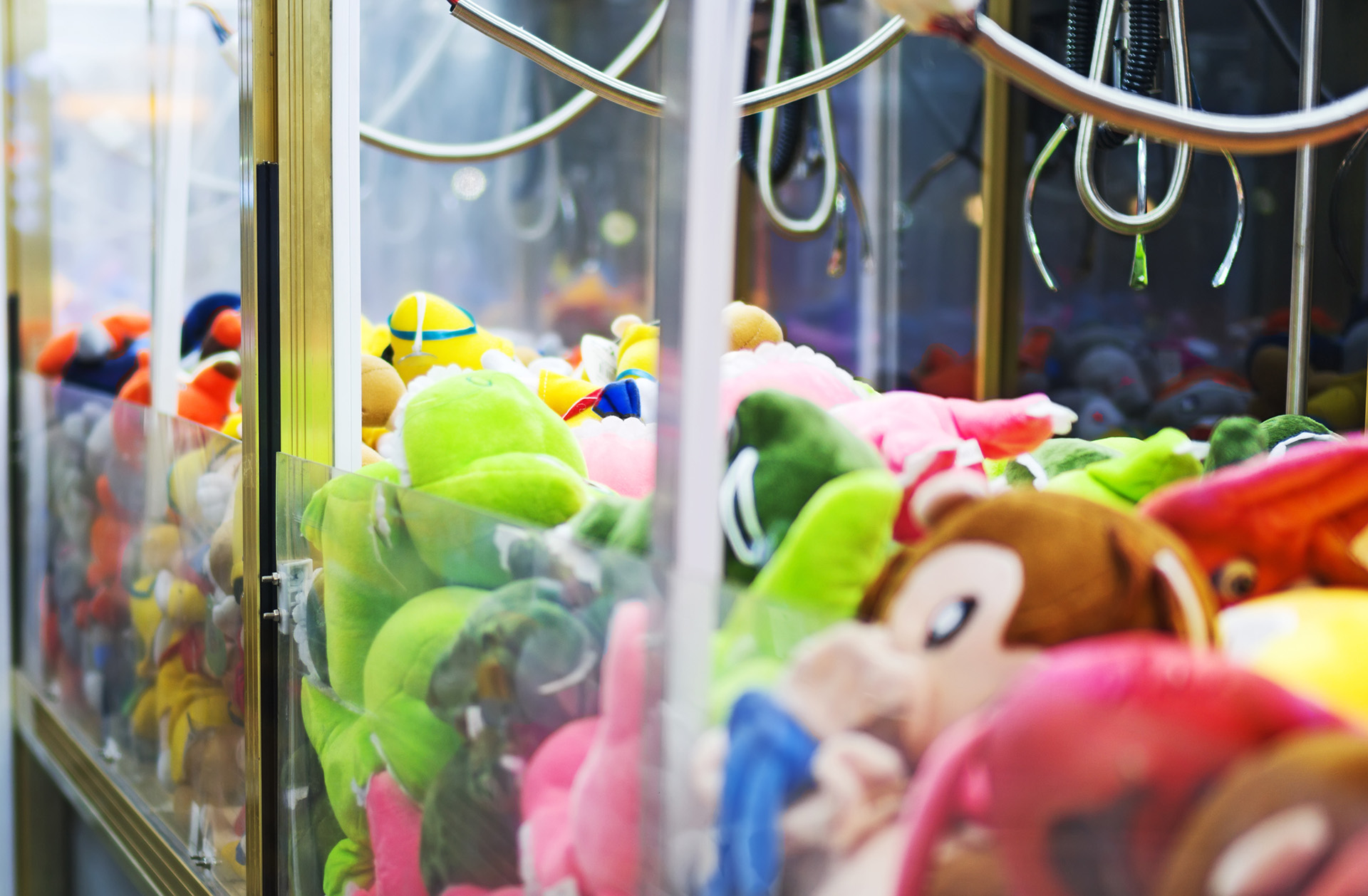 arcade claw over different toys